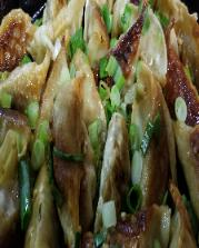 Homemade lamb Pho potstickers with Soy,ginger,Sake,green onion dipping sauce